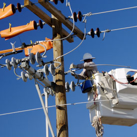 lineman with rubber safety gear